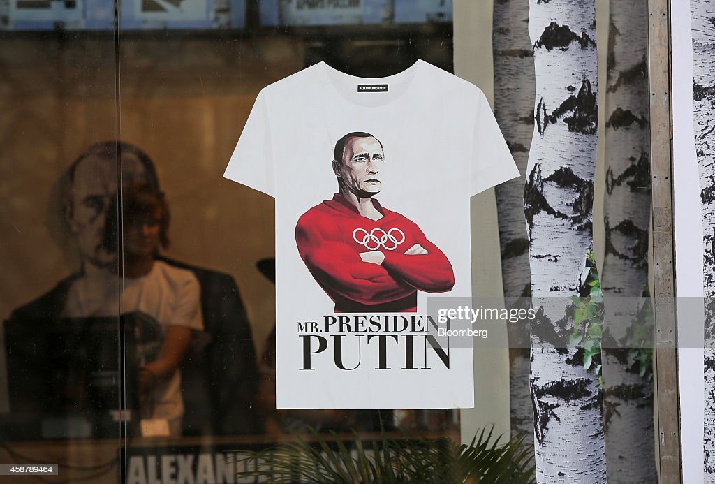 A tshirt design depicting Russia's President Vladimir Putin as an Olympic strongman sits in the window of an Alexander Konasov clothing store to...