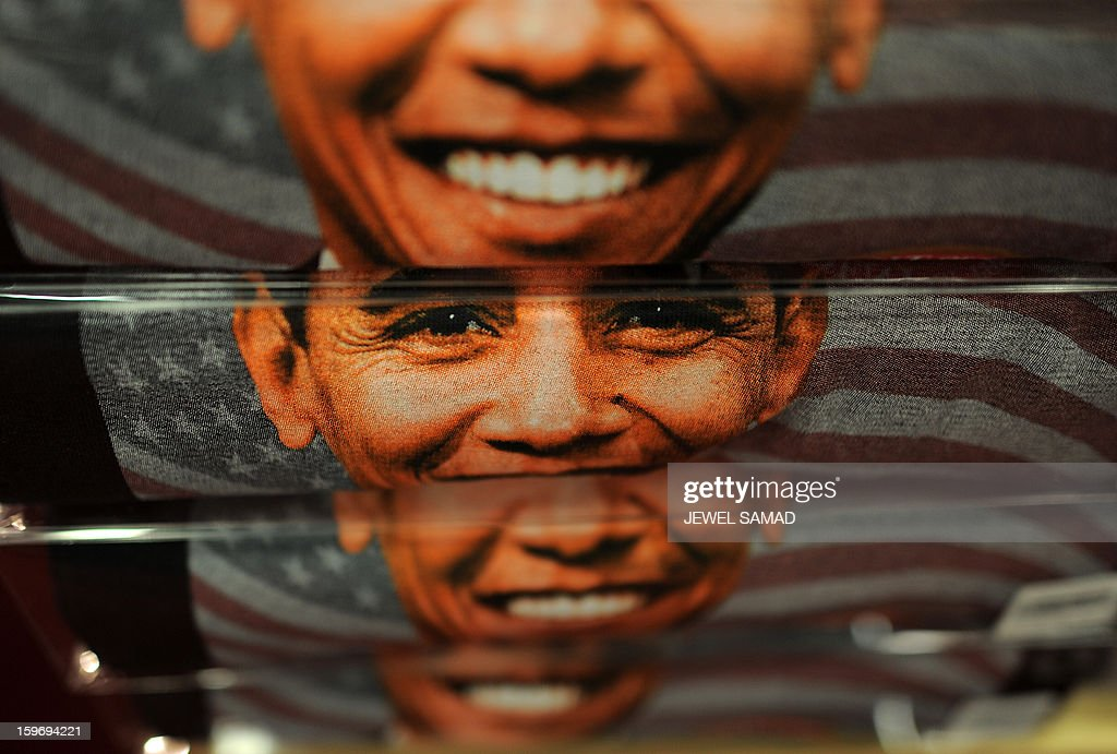 T-shirts featuring an image of US President Barack Obama are displayed at a gift shop in Washington, DC, on January 18, 2013. Crowds may be smaller on January 21 inauguration than when Barack Obama was first sworn into office in 2009, but security is as tight as ever, with experts warning a 'lone wolf' would pose the greatest threat. Between 500,000 and 800,000 people are expected to pass through the National Mall, the immense greenway that leads up to the Capitol, compared to the 1.8 million spectators who came to applaud Obama four years ago. AFP PHOTO/Jewel Samad