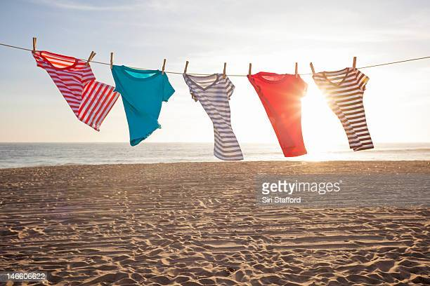 T-Shirts hanging on a clothesline at the beach