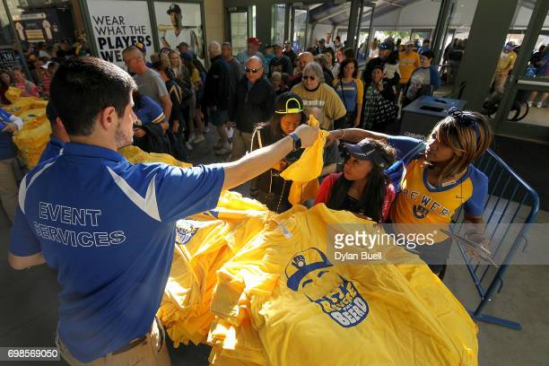 Tshirts in honor of Eric Thames of the Milwaukee Brewers are given to fans before the game against the Pittsburgh Pirates at Miller Park on June 19...