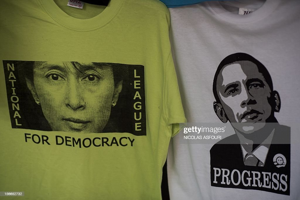 T-shirts of Myanmar pro-democracy leader Aung San Suu Kyi (L) and US President Barack Obama (R) are displayed for sale at a market in Yangon on November 18, 2012. US President Barack Obama landed in Thailand on November 18, intensifying his diplomatic 'pivot' to Asia, on a tour which will see him make history by visiting Myanmar in a bid to encourage political reform. AFP PHOTO/ Nicolas ASFOURI