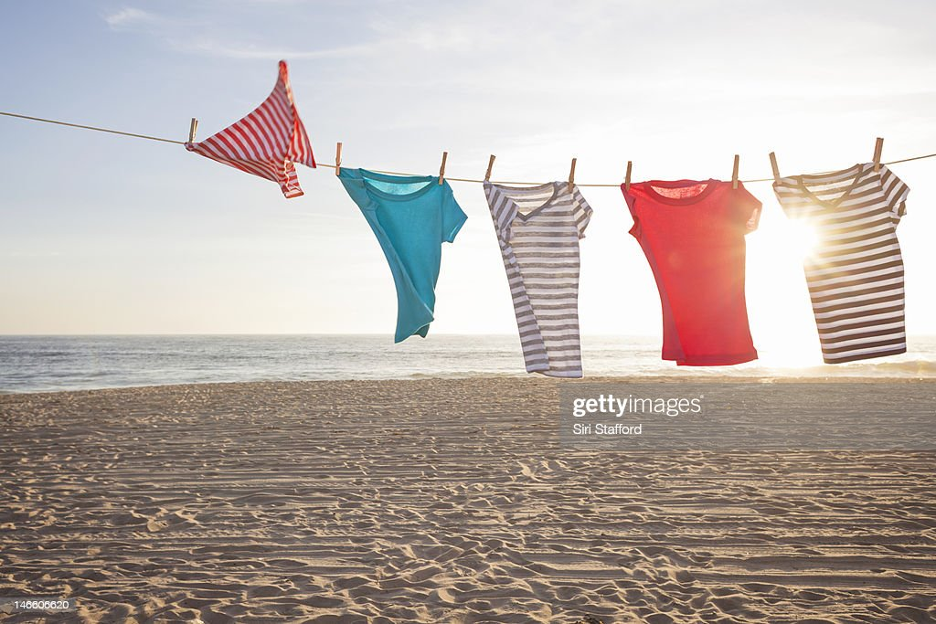 T-shirts on a clothesline at a beach : Stock Photo