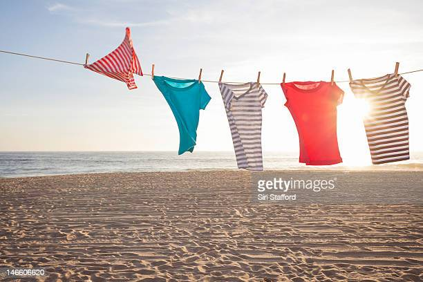 T-shirts on a clothesline at a beach
