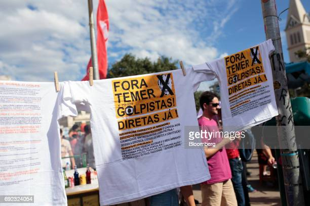 Tshirts that read 'Temer And All Coup Plotters Out Direct Elections Now' are displayed during a protest against Brazilian President Michel Temer and...
