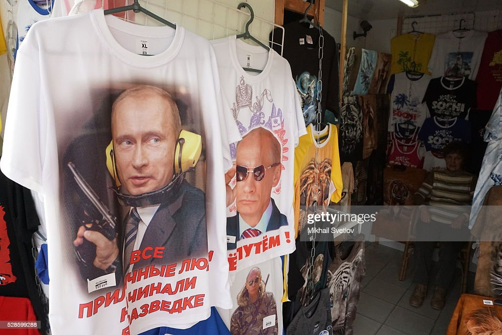 T-shirts with a portrait of Russian President Vladimir Putin holding a gun are seen in a shop in the Black Sea resort of Sochi, Russia on May 5, 2016. Putin is having a trip to meet Japanese Prime Minister Shinzo Abe.