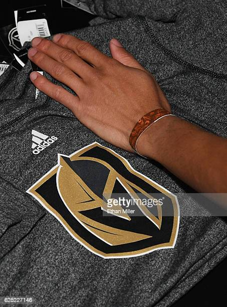 Tshirts with the team logo for the Vegas Golden Knights are folded and stacked after being announced as the name for the Las Vegas NHL franchise at...
