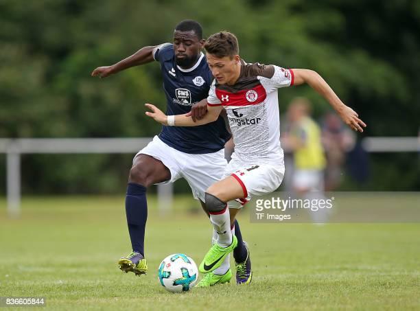 Tshomba Luvumbu Oliveira of Oldenburg and Maurice Jerome Litka of St Pauli battle for the ball during the preseason friendly match between VfB...