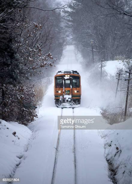 Tsugaru Railways train runs through a snow field on February 1 2017 in Aomori Japan The Tsugaru Railways connecting between Tsugaru Goshogawara and...