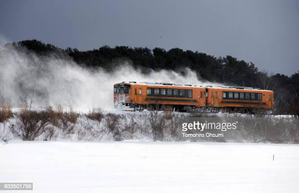 Tsugaru Railways train runs through a snow field on February 2 2017 in Aomori Japan The Tsugaru Railways connecting between Tsugaru Goshogawara and...