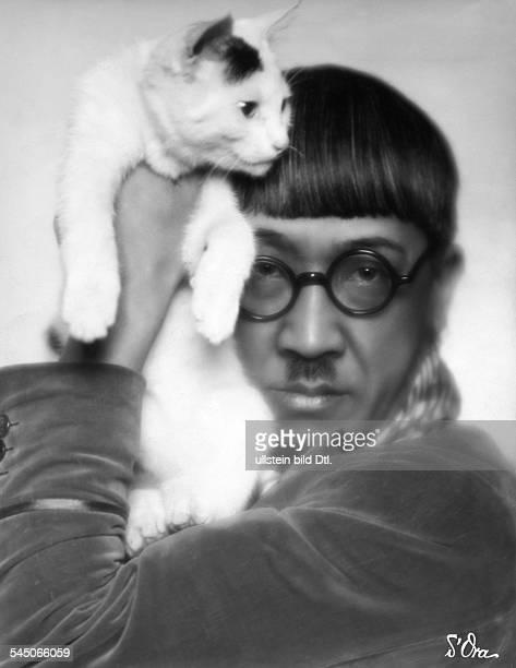 Tsuguharu Foujita artist painter printmaker Japanposing with a catPublished in Dame 22/1927 Uhu 8/1932Photographer d'Ora