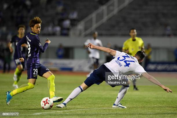 Tsukasa Morishima of Sanfrecce Hiroshima and Milos Degenek of Yokohama FMarinos compete for the ball during the JLeague J1 match between Sanfrecce...