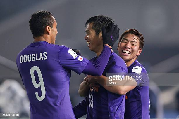 Tsukasa Shiotani of Sanfrecce Hiroshima celebrates with teammates after scoring a goal during FIFA Club World Cup Playoff match for the quarter final...