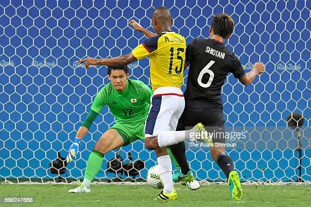 Tsukasa Shiotani of Japan and Wilmar Barrios of Colombia compete for the ball during 2016 Summer Olympics match between Japan and Colombia at Arena...