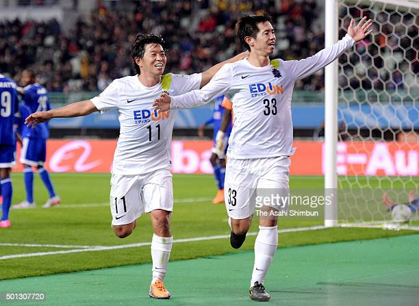 Tsukasa Shiotani of Sanfrecce Hiroshima celebrates scoring his team's first goal with his team mate Hisato Sato during the the FIFA Club World Cup...