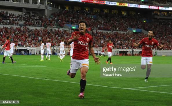Tsukasa Umesaki of Urawa Red Diamonds celebrates the first goal during the J League match between Urawa Red Diamonds and Omiya Ardija at Saitama...