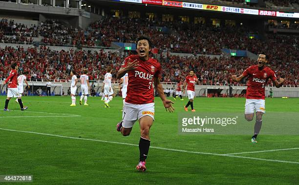 Tsukasa Umesaki of Urawa Red Diamonds celebrates the first goal during the J League match between Urawa Red Diamonds and Omiya Ardija at Saitama...