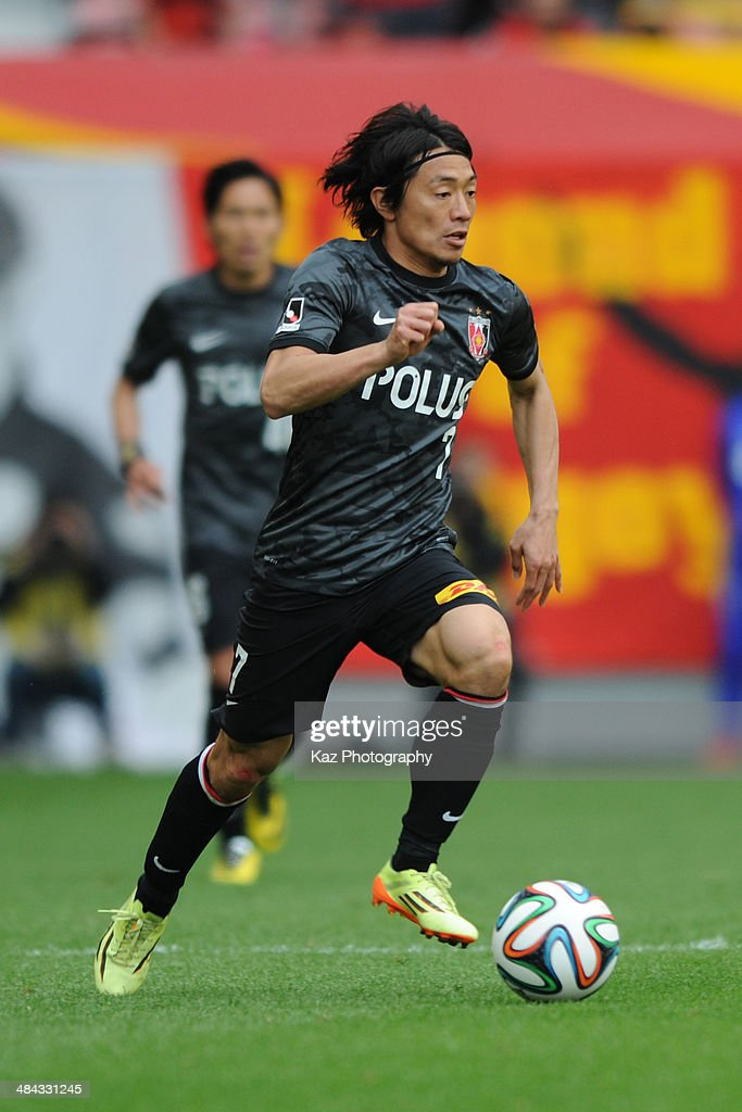 Tsukasa Umesaki of Urawa Red Diamonds dribbles the ball during the J. League match between Nagoya Grampus and Urawa Red Diamonds at the Toyota Stadium on April 12, 2014 in Toyota, Japan.