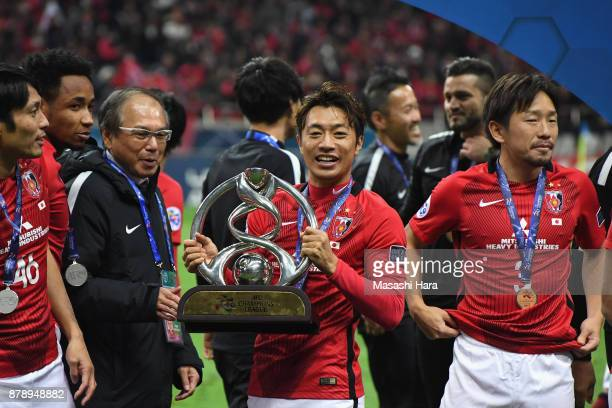 Tsukasa Umesaki of Urawa Red Diamonds holds the AFC Champions League trophy after the AFC Champions League Final second leg match between Urawa Red...