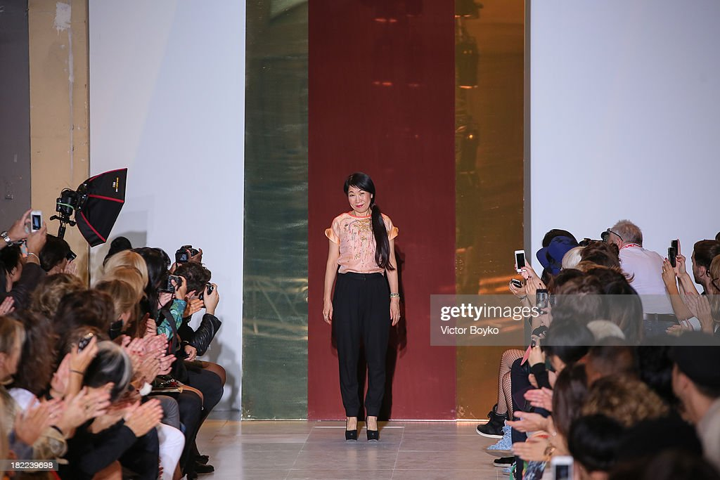 Tsumori Chisato walks the runway during Tsumori Chisato show as part of the Paris Fashion Week Womenswear Spring/Summer 2014 on September 28, 2013 in Paris, France.