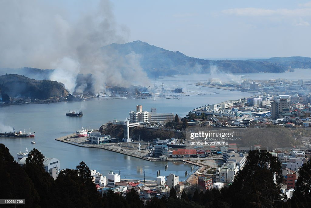 CONTENT] Tsunami attacked kesennuma city in mar 11th. Here is a typical area in kesennuma city miyagi pref. This is kesennuma bay area view from mountaintop in 311 next day noon. Left side was burning in Mar 11th allnight. and kesennuma town clad in black seafloor mud.