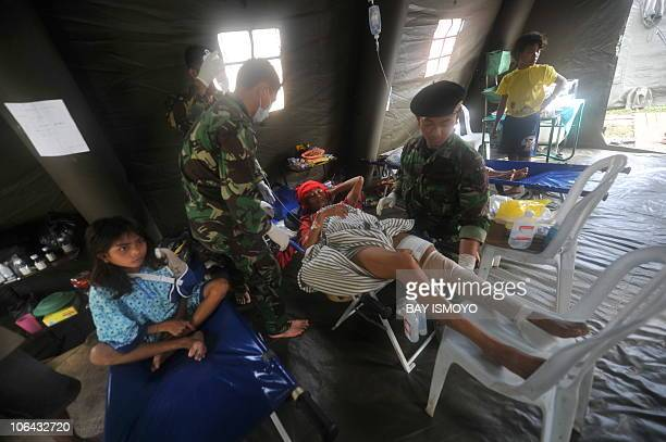 Tsunami survivors recieve treatment at an Indonesian army field hospital at Sikakap village in South Pagai in the Metawai islands west of Sumatra...