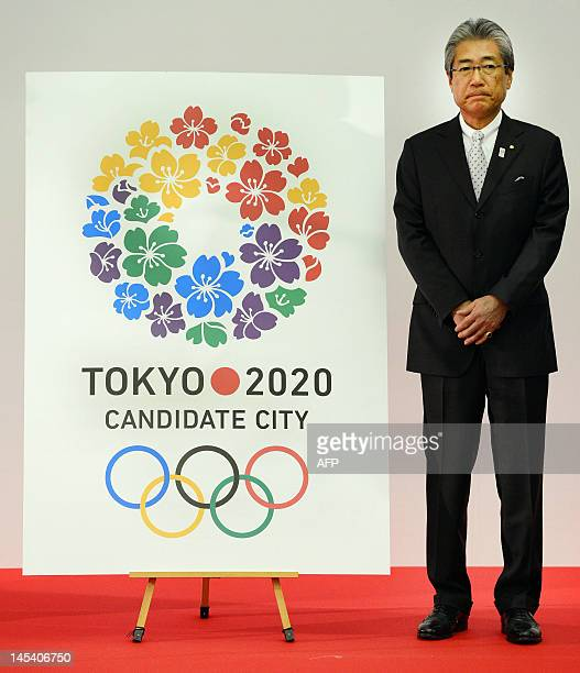 Tsunekazu Takeda president of the Tokyo 2020 Bid Committee unveils the new logo for their 2020 Summer Olympics bid at the metropolitan government...