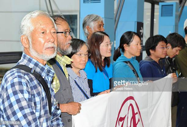 Tsuneo Shigehiro a 69yearold climber and his party arrive at Kansai International Airport in western Japan on Nov 8 after scaling the unclimbed...