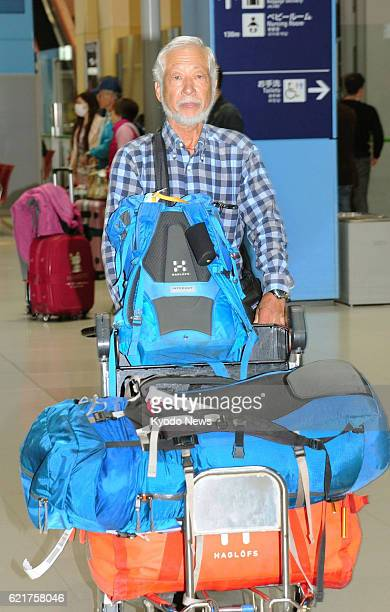 Tsuneo Shigehiro a 69yearold climber arrives at Kansai International Airport in western Japan on Nov 8 after scaling the unclimbed summit of...
