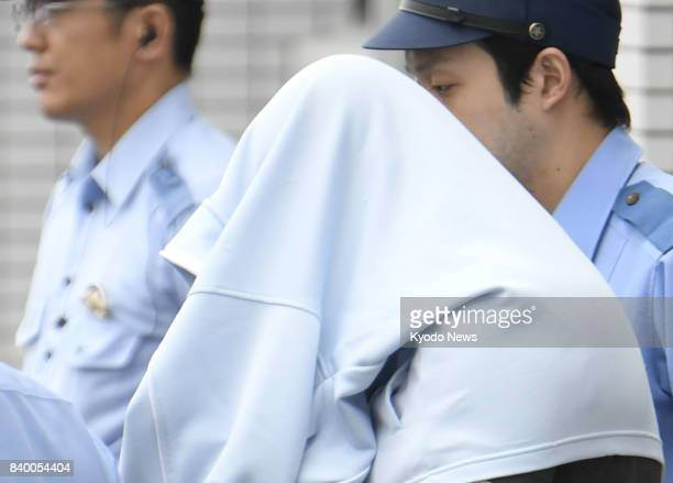 Tsuneo Shinozaki who heads a cord blood sales company in Tsukuba northeast of Tokyo has his face covered in Matsuyama western Japan on Aug 28 as he...