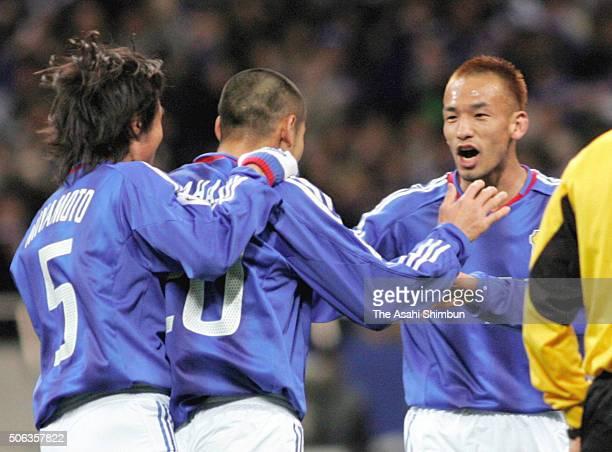 Tsuneyasu Miyamoto Naohiro Takahara and Hidetoshi Nakata of Japan celebraet their first goal scored by Mohamed Salmeen of Bahrain during the FIFA...