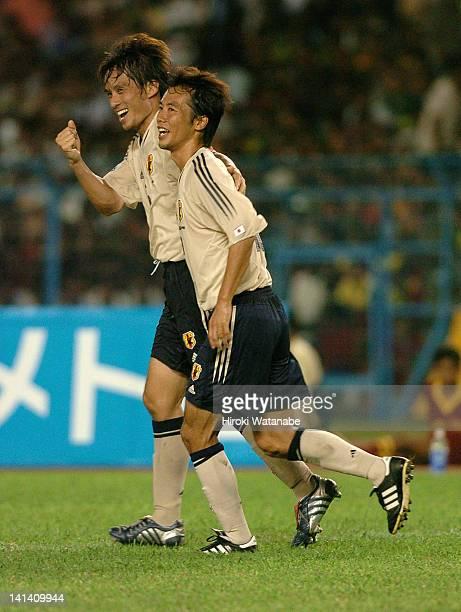 Tsuneyasu Miyamoto of Japan celebrates scoring the fourth goal with his teammate Toshiya Fujita during the FIFA World Cup Asian Qualifier match...