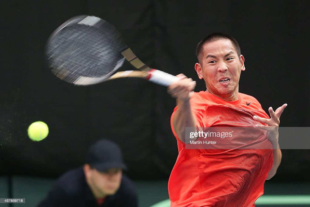 <a gi-track='captionPersonalityLinkClicked' href=/galleries/search?phrase=Tsung-Hua+Yang&family=editorial&specificpeople=4835216 ng-click='$event.stopPropagation()'>Tsung-Hua Yang</a> of Chinese Taipaei in action against Artem Sitak of New Zealand during day three of the Davis Cup during the Davis Cup tie between New Zealand and Chinese Taipei at Wilding Park on October 26, 2014 in Christchurch, New Zealand.