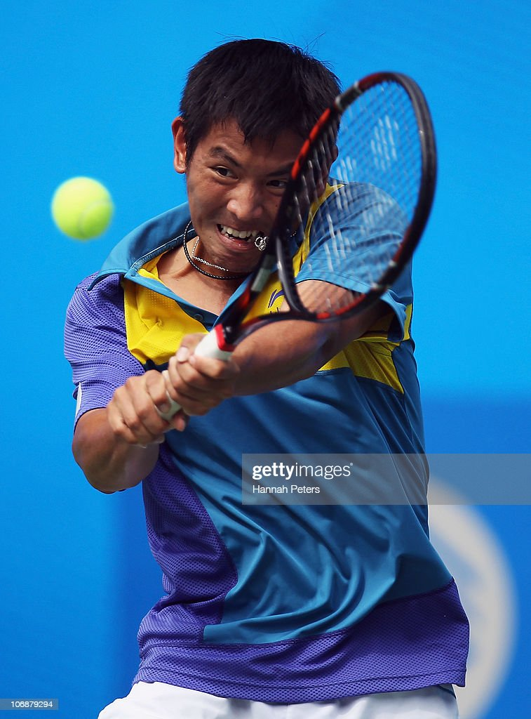 <a gi-track='captionPersonalityLinkClicked' href=/galleries/search?phrase=Tsung-Hua+Yang&family=editorial&specificpeople=4835216 ng-click='$event.stopPropagation()'>Tsung-Hua Yang</a> of Chinese Taipei plays a backhand in the Men's Team Tennis Semifinal match against Sanam Singh of India at Aoti Tennis Centre during day three of the 16th Asian Games Guangzhou 2010 on November 15, 2010 in Guangzhou, China.