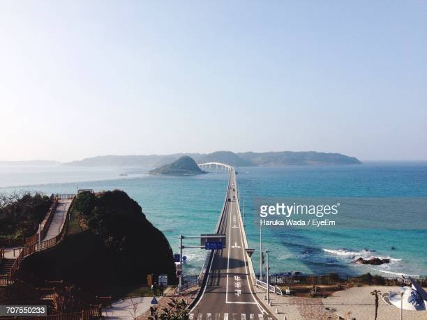 Tsunoshima Ohashi Bridge Over Sea Against Clear Sky