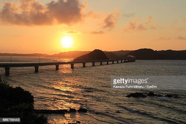 Tsunoshima Ohashi Bridge Over Sea Against Sky During Sunset