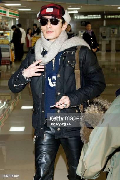 Tsuyoshi Kusanagi of Japanese boy band SMAP known as Chonan Gang is seen on departure at Gimpo International Airport on February 4 2013 in Seoul...