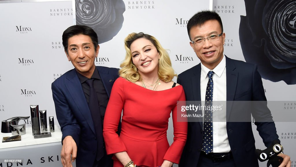 Tsuyoshi Matsushita, President of MTG Co., Ltd, Madonna and Alvin Liu, CEO Alibaba Global launch MDNA SKIN collection at Barneys New York on September 26, 2017 in New York City.