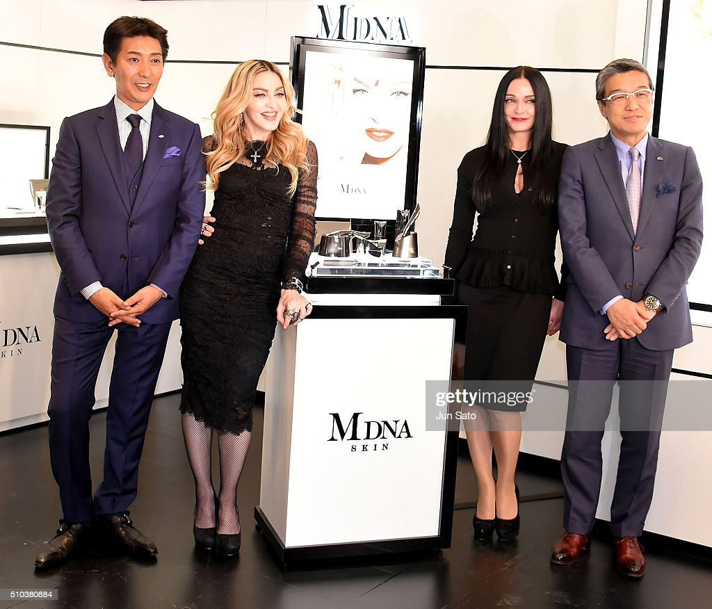 Tsuyoshi Matsushita, president of MTG Co., Ltd., Madonna, Michelle Peck, facialist to Madonna and Hiroshi Ohnishi, President and CEO, Mitsukoshi Isetan Holdings Ltd. attend the promotional event for 'MDNA SKIN' on February 15, 2016 in Tokyo, Japan.