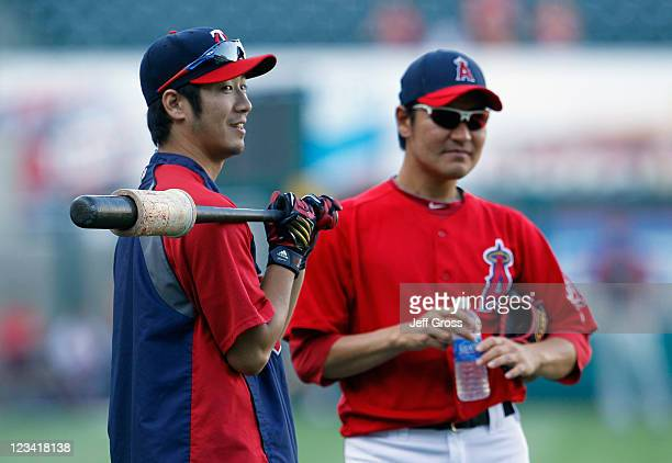 Tsuyoshi Nishioka of the Minnesota Twins and Hisanori Takahashi of the Los Angeles Angels of Anaheim talk prior to the start of the game at Angel...