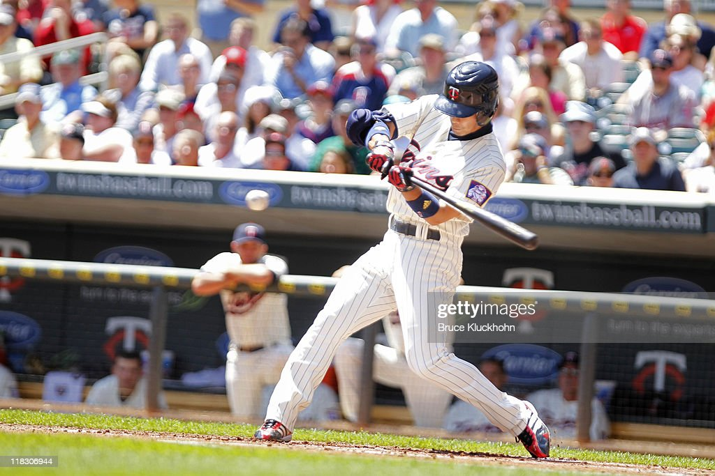 <a gi-track='captionPersonalityLinkClicked' href=/galleries/search?phrase=Tsuyoshi+Nishioka&family=editorial&specificpeople=690357 ng-click='$event.stopPropagation()'>Tsuyoshi Nishioka</a> #1 of the Minnesota Twins bats against the Los Angeles Dodgers on June 29, 2011 at Target Field in Minneapolis, Minnesota. The Twins won 1-0.