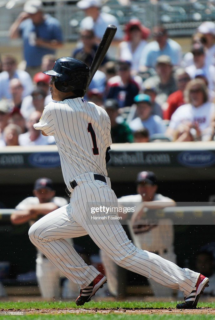 <a gi-track='captionPersonalityLinkClicked' href=/galleries/search?phrase=Tsuyoshi+Nishioka&family=editorial&specificpeople=690357 ng-click='$event.stopPropagation()'>Tsuyoshi Nishioka</a> #1 of the Minnesota Twins hits an RBI single against the Los Angeles Dodgers in the first inning on June 29, 2011 at Target Field in Minneapolis, Minnesota.