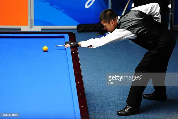 Tsuyoshi Suzuki of Japan competes during the men's carom 3 cushion singles final against Joji Kai of Japan at the 16th Asian Games in Guangzhou on...