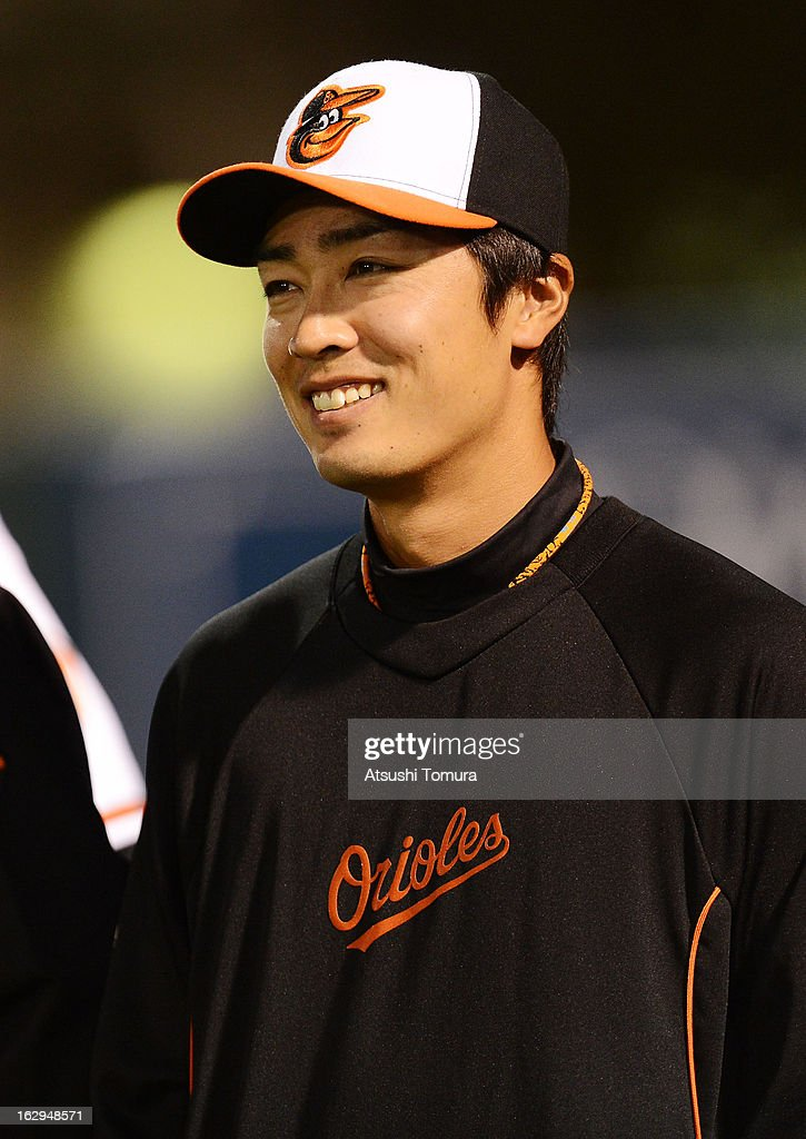 Tsuyoshi Wada #18 of Baltimore Orioles looks on during the spring training game against Boston Red Sox at Ed Smith Stadium on February 27, 2013 in Sarasota, Florida.