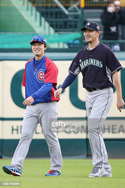 Tsuyoshi Wada of the Chicago Cubs and Hisashi Iwakuma of the Seattle Mariners smile during the friendly match between Hanshin Tigers and Yomiuri...