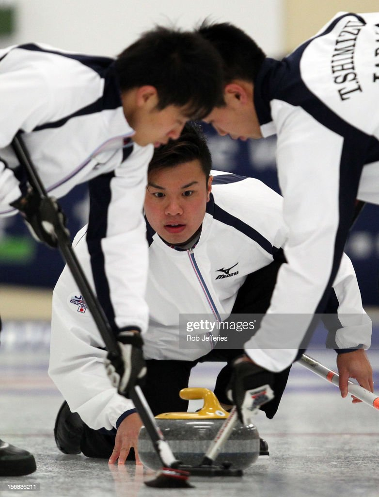 Tsuyoshi Yamaguchi of Japan delivers his stone during the Pacific Asia 2012 Curling Championship at the Naseby Indoor Curling Arena on November 23, 2012 in Naseby, New Zealand.