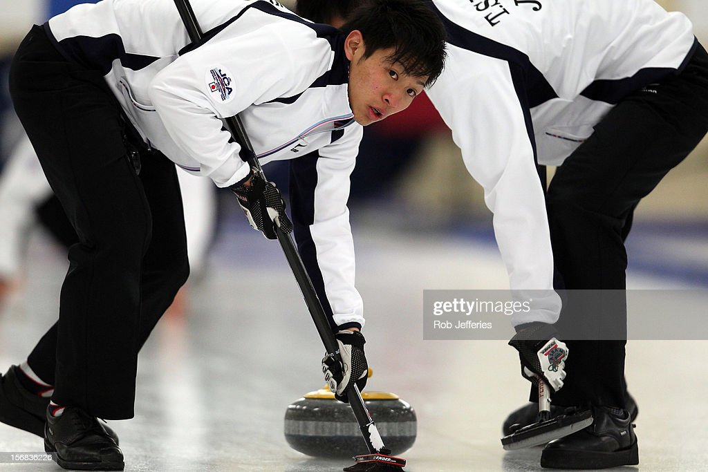 Tsuyoshi Yamaguchi of Japan sweeps during the Pacific Asia 2012 Curling Championship at the Naseby Indoor Curling Arena on November 23, 2012 in Naseby, New Zealand.