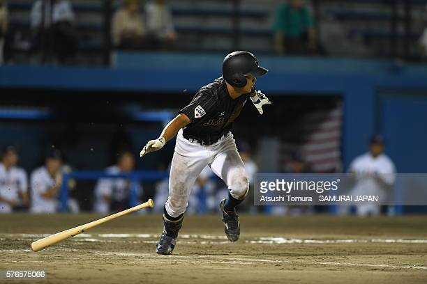 Tsuyoshi Yamasaki of Japan hits a single in top of the 9th inning on the day 4 match between USA and Japan during the 40th USAJapan International...