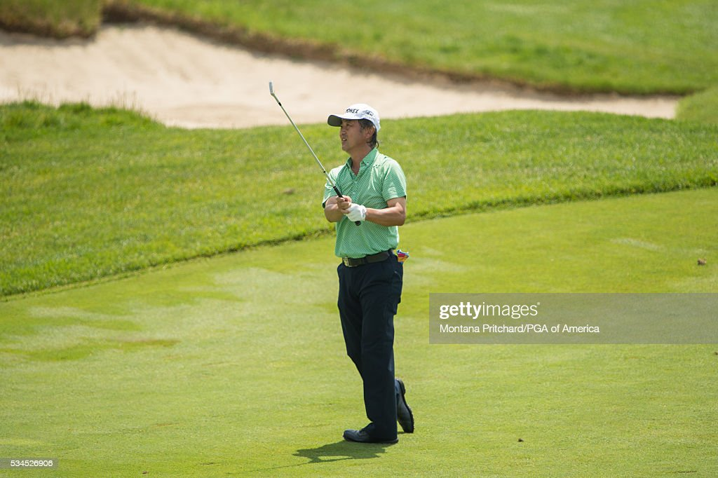 Tsuyoshi Yoneyama of Japan hits his shot on the sixth hole during the first round for the 77th Senior PGA Championship presented by KitchenAid held at Harbor Shores Golf Club on May 26, 2016 in Benton Harbor, Michigan.