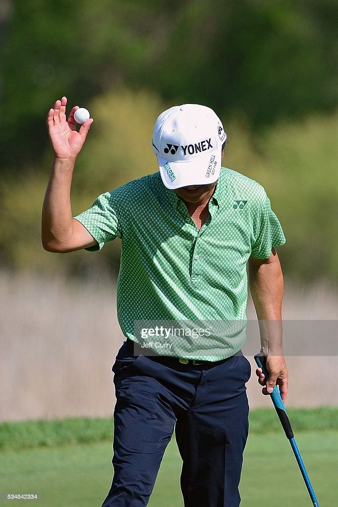 Tsuyoshi Yoneyama of Japan waves to the fans after sinking a putt on the 16th hole during the first round 2016 Senior PGA Championship presented by KitchenAid at the Golf Club at Harbor Shores on May 26, 2016 in Benton Harbor, Michigan.