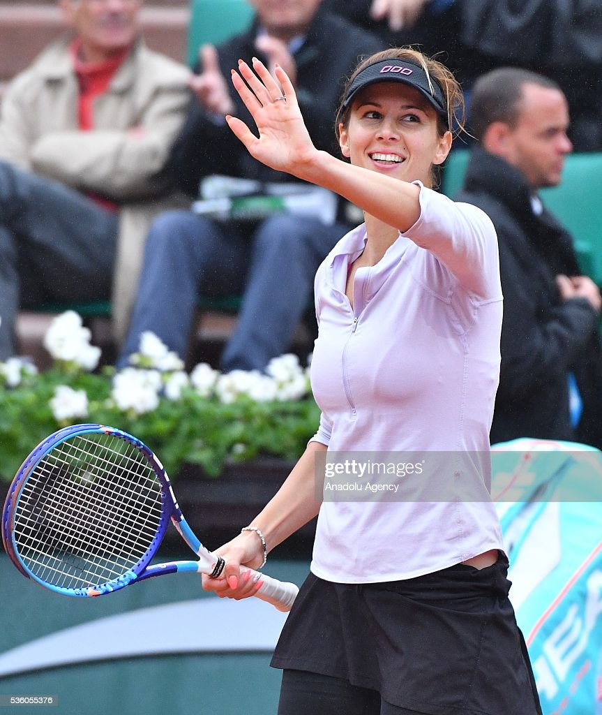 Tsvetana Pironkova of Bulgaria celebrates her victory after winning the match against Agnieszka Radwanska of Poland during the women's single fourth round match at the French Open tennis tournament at Roland Garros Stadium in Paris, France on May 29, 2016.